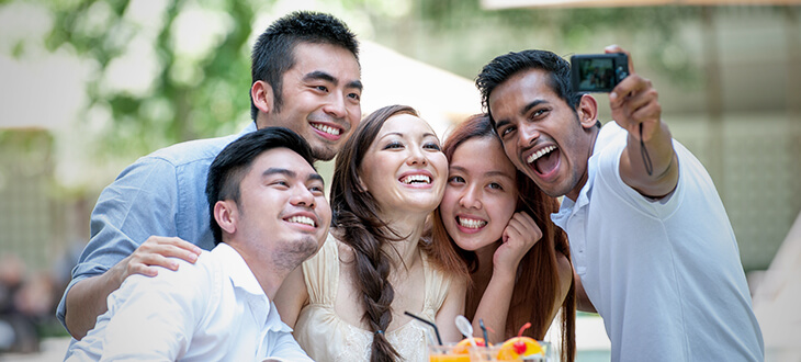 A group of asian friends taking selfies