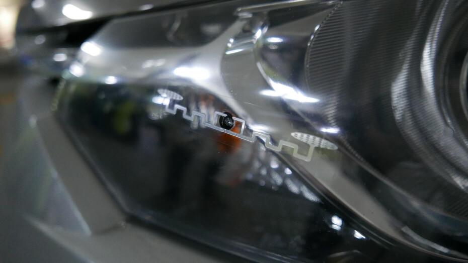 Touch n' Go RFID sticker on car headlamp